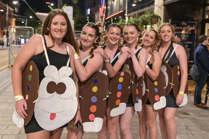Six girls walked in as a delicious treat for Colin the Caterpillar cake