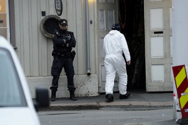 Forensic police officers at the scene this morning