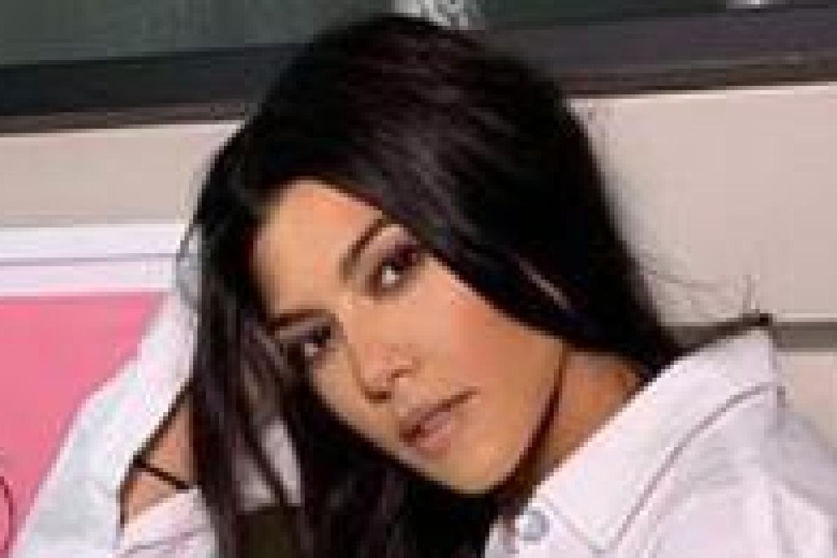 Kourtney Kardashian strips down to worlds tiniest thong