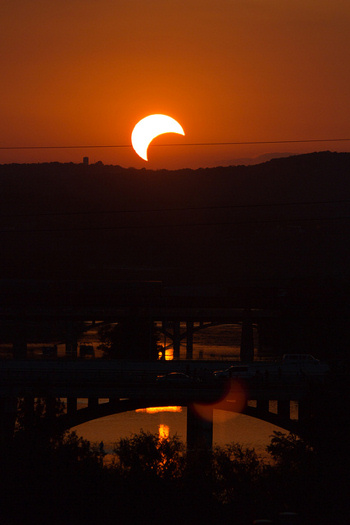Photo of partial solar eclipse as seen near sunset on May 20, 2012, from Austin, Texas. This time around, eastern North America will see a partial solar eclipse just after sunrise on November 3, 2013. Image credit: mrlaugh's photostream