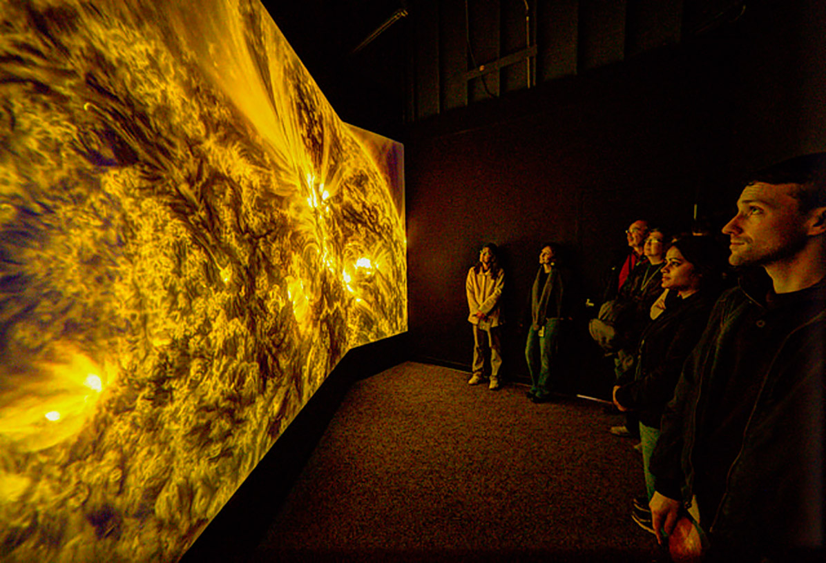 A crowd looks at Solarium in February 2015 at the Goddard Visitor Center in Greenbelt, MD. Photo Credit: NASA's Goddard Space Flight Center