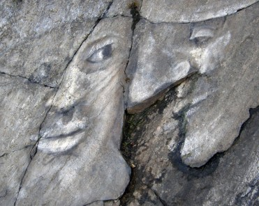 Painted stone faces - a nose and a conversation