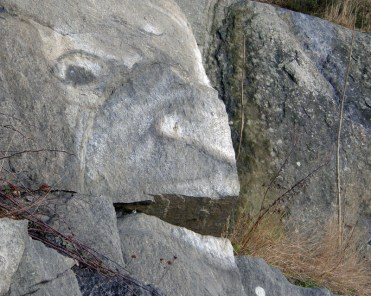 Painted stone face - big mouth