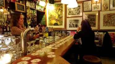 Maastricht: The bar and barmaid at Café de Pieter, Pieterstraat