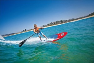 man riding wave on bic sport ace tec paddle board