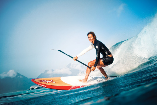 female on stand up paddle board in the surf
