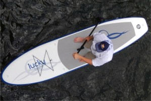 man paddling lucky bums inflatable sup