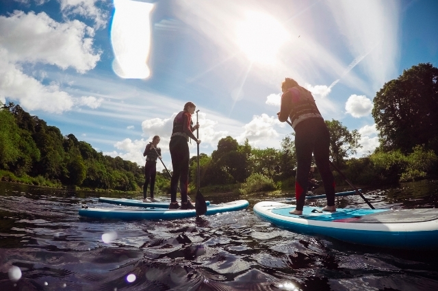 learn where to stand on paddle board from experts