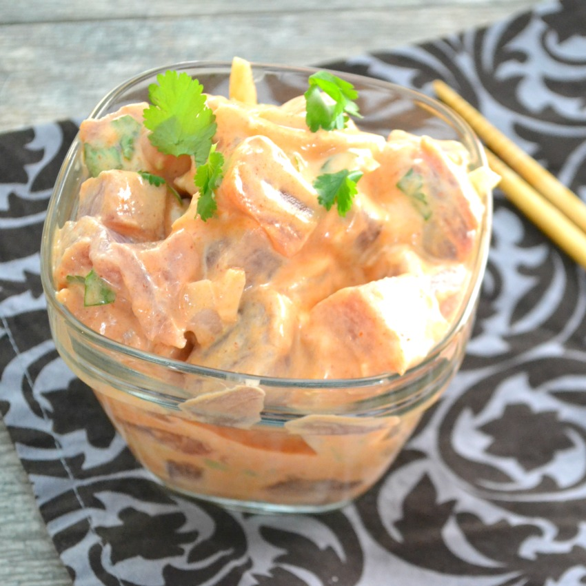 Spicy Tuna Poke uses fresh tuna and a few common ingredients for an amazing flavor. This is all we eat when we are in Hawaii and now we can make it home. | www.thesurferskitchen.com