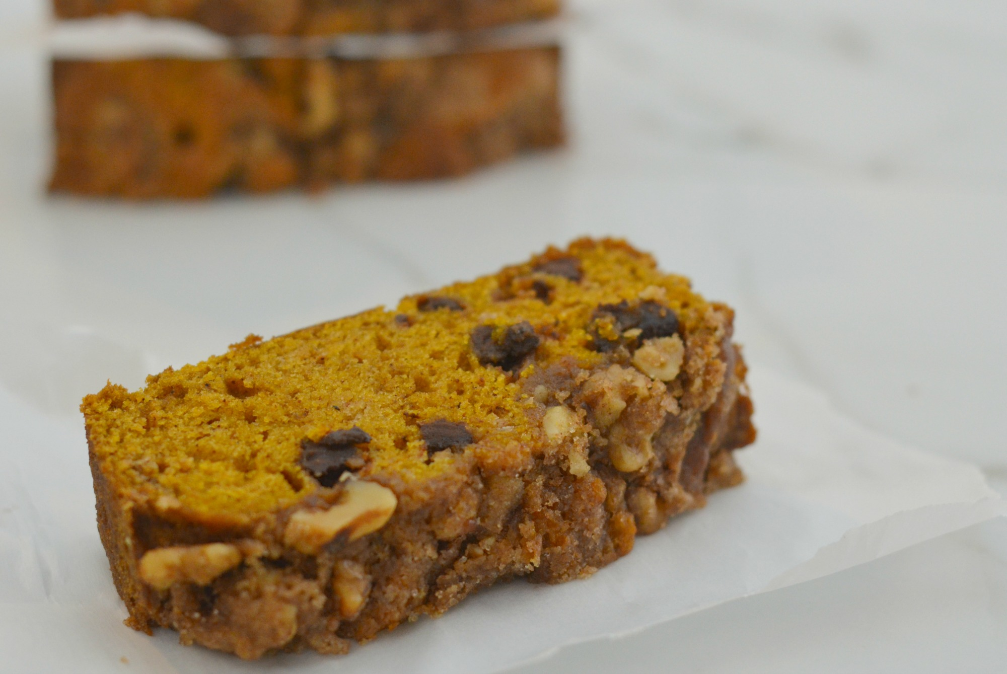 Chocolate Chip Pumpkin Bread| My basic pumpkin bread recipe with added chocolate and a special topping. So good! | www.thesurferskitchen.com