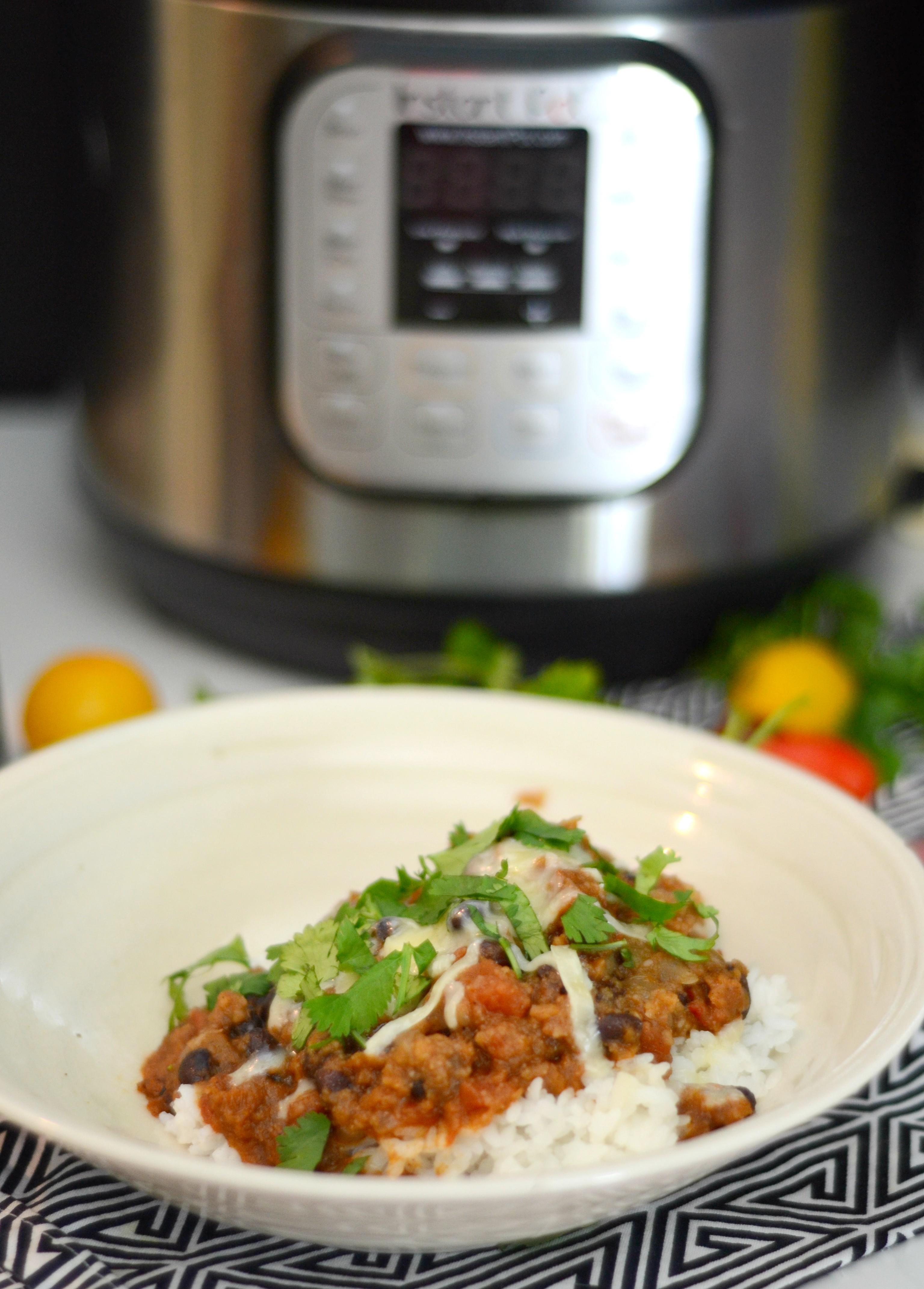 Bowl of Vegetarian Chili with Instant Pot in background