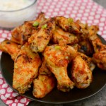 PLatter of spicy chicken wings with dipping sauce