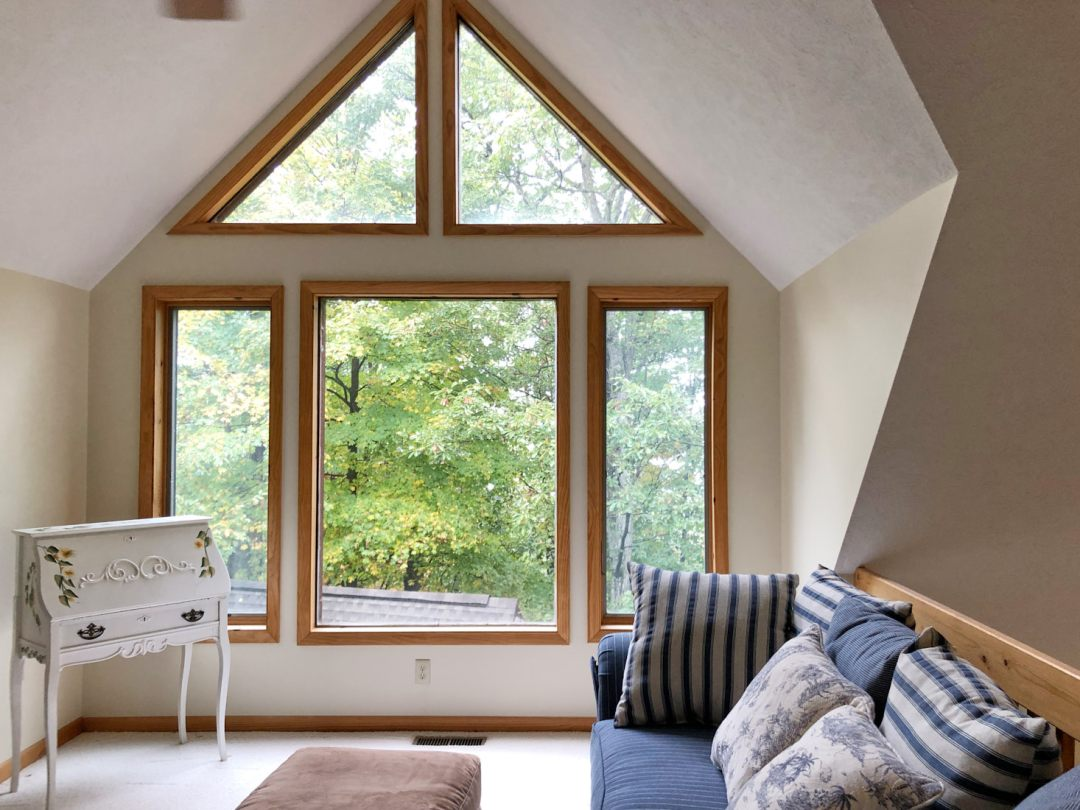 Triangle windows in loft living room