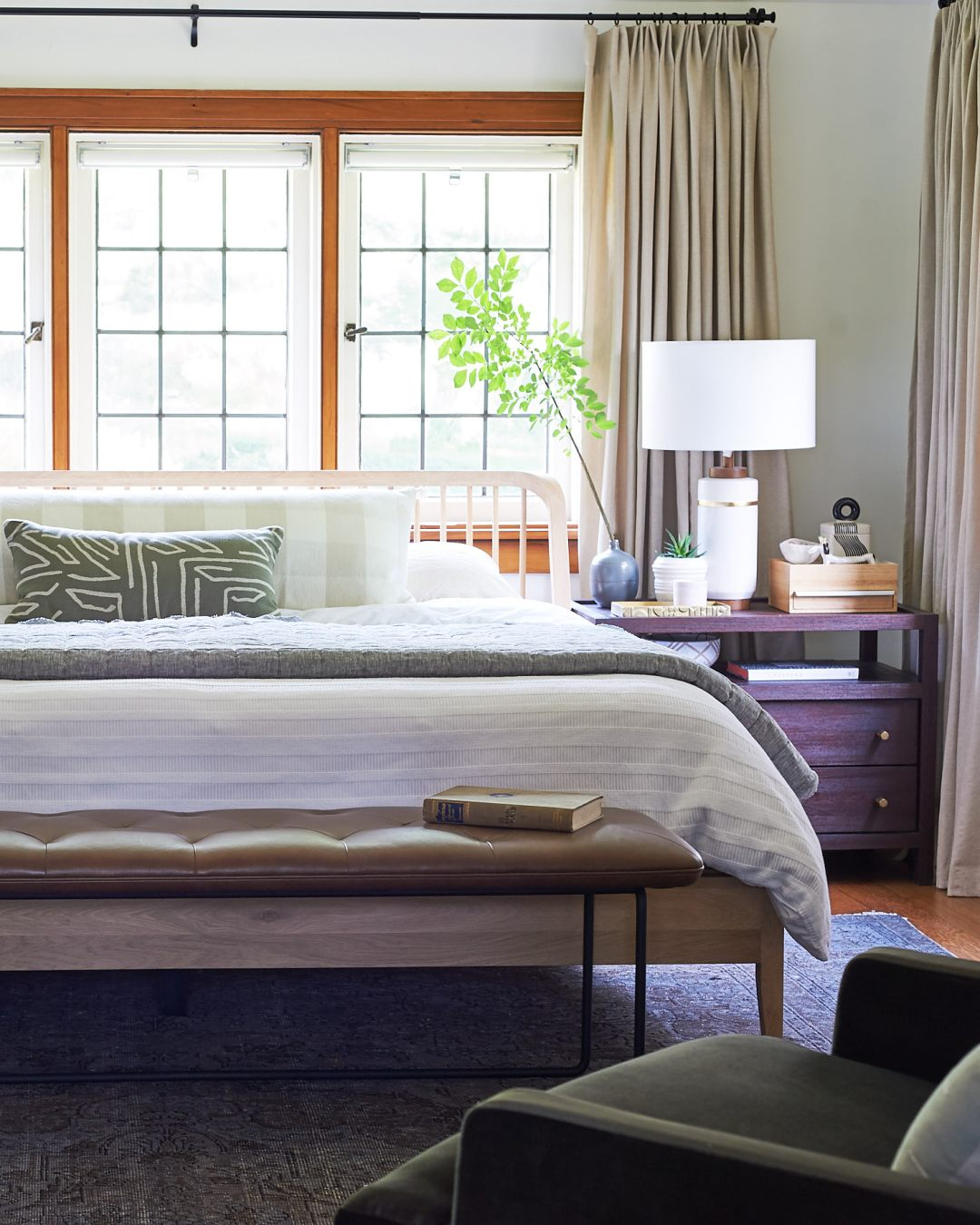 Bedroom with bench at foot of bed