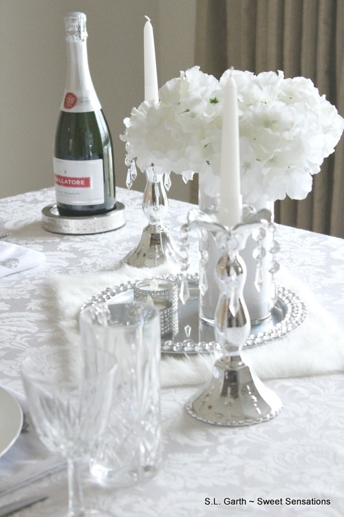 Love is in the air and to celebrate I've put together this Romantic Tablescape For Two in Silver and White.