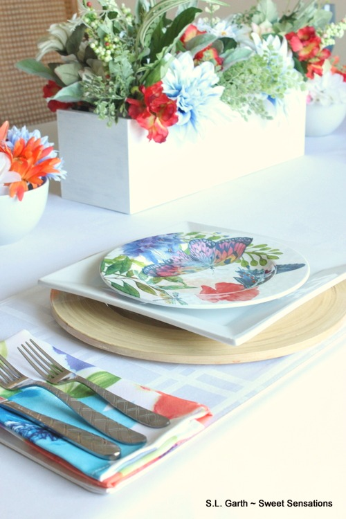 This watercolor inspired spring table came about from pretty watercolor napkins and salad plates with a butterfly motif.