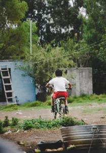 Mexican child riding a bicycle