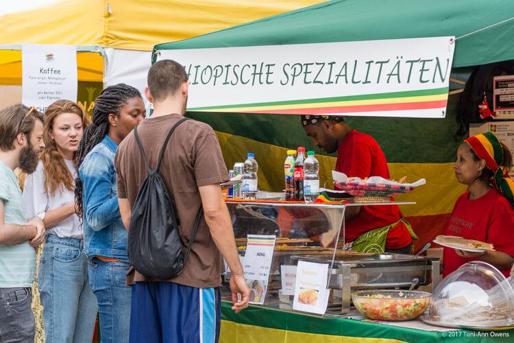 An interracial couple ordering Ethiopian food