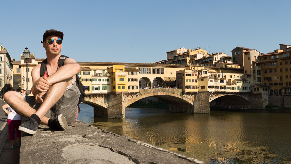 Jerry Sitting with the Ponte Vecchio Bridge in Florence, Italy