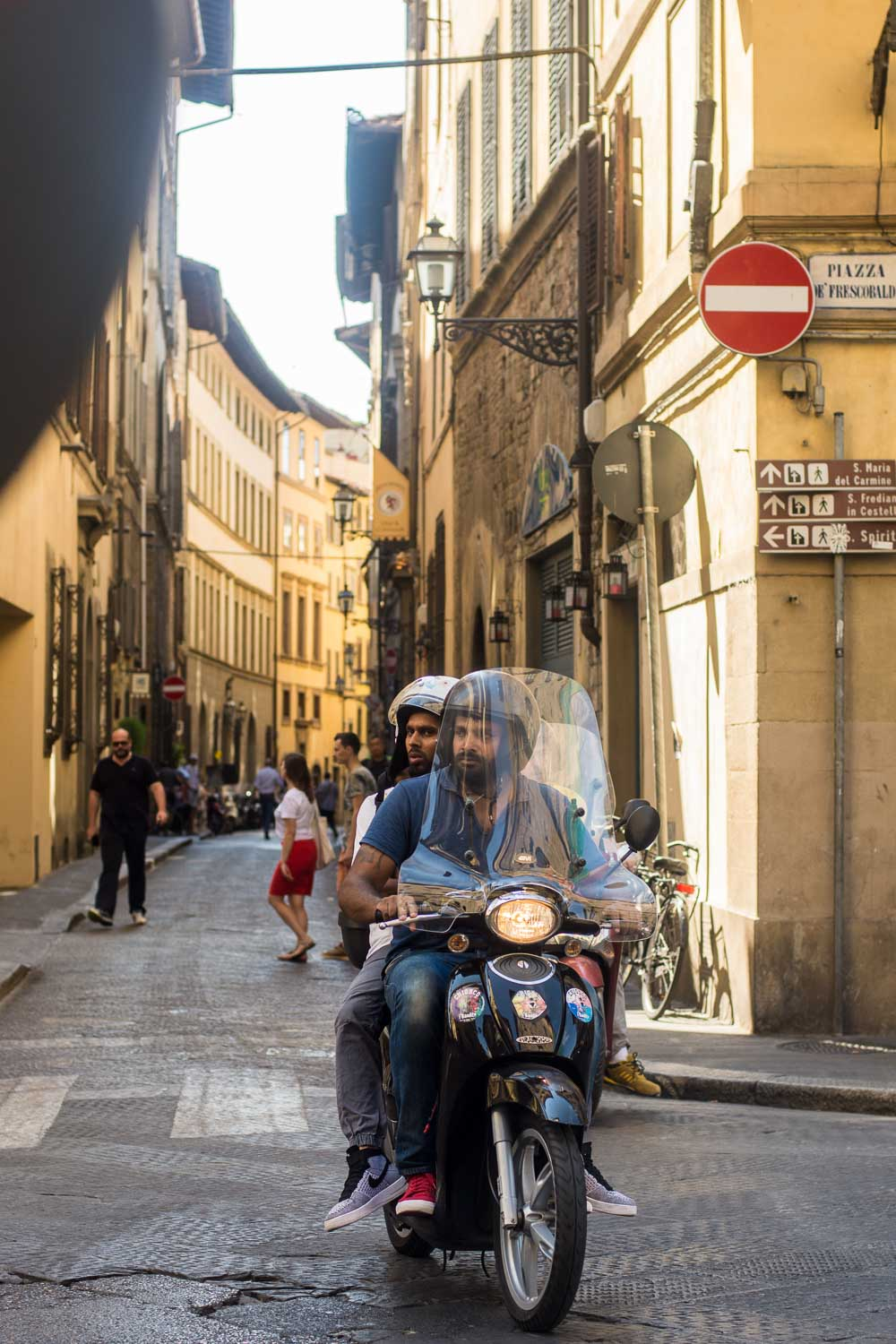 Vespa Riders in Florence, Italy