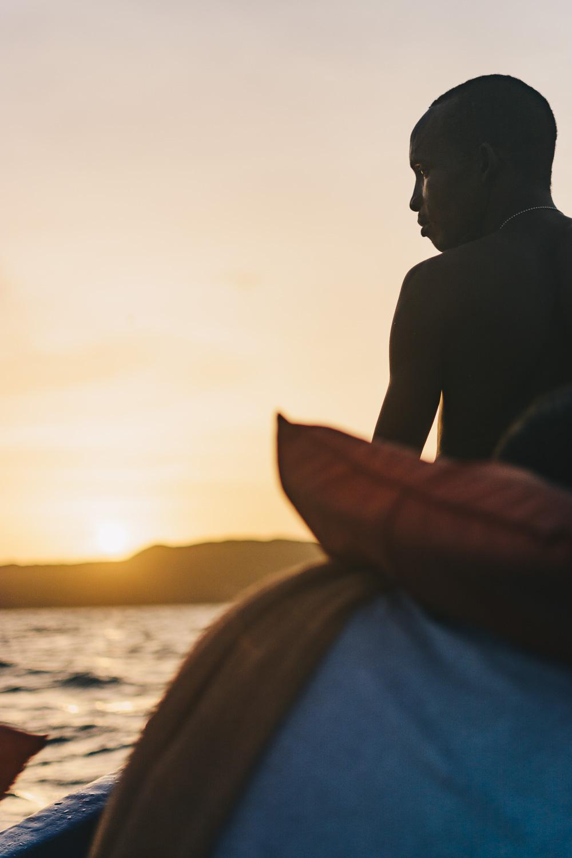 Fisherman steering the boat back to Kingston