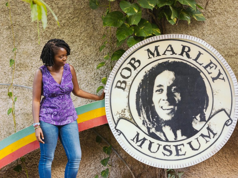 Girl Standing by the Bob Marley Museum in Kingston Jamaica