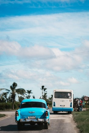 People getting on to a local bus in Cuba