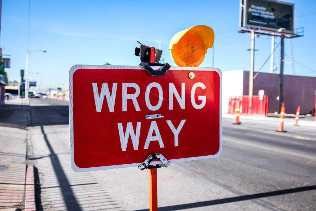 wrong-way sign on street