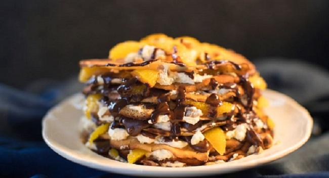 Siúcra & Catherine Fulvio's Pancake Stack Recipe with Orange Segments, Chocolate Fudge Sauce and Toasted Hazelnuts