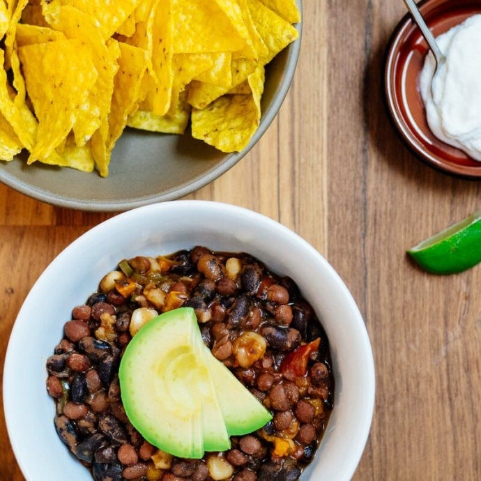 Posole made with Rancho Gordo beans and hominy served with chips, yogurt, and avocado.