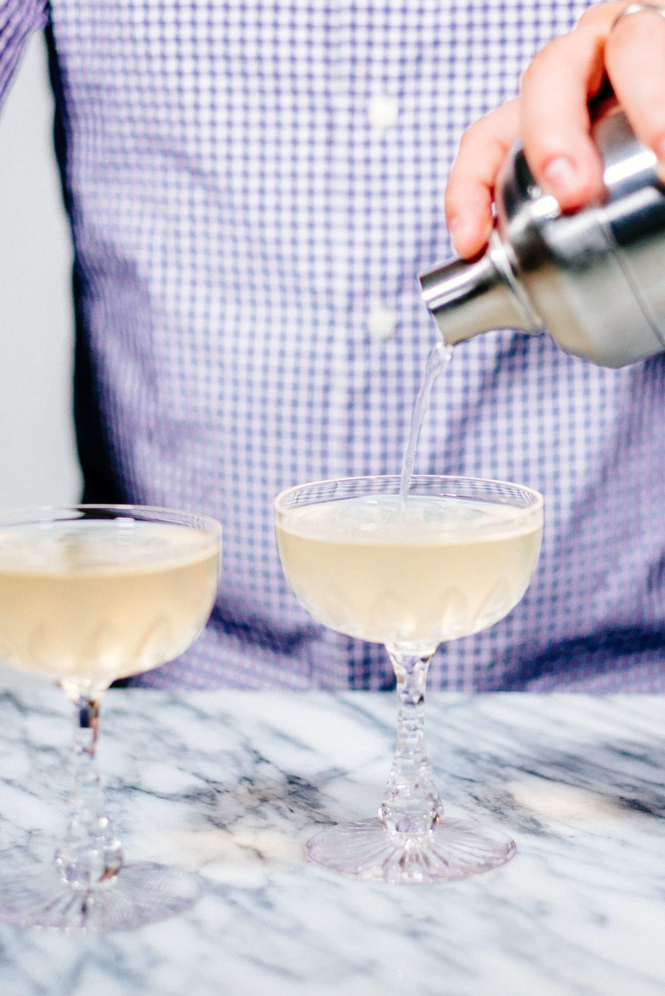 Pouring the El Guapo Gimlet into coupes
