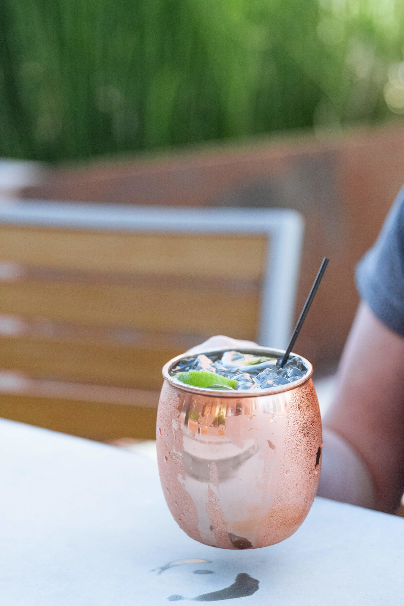 Drinking a green chili moscow mule cocktail