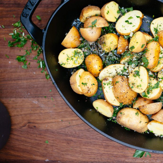 Herb roasted potatoes ready for the oven with french gray sea salt