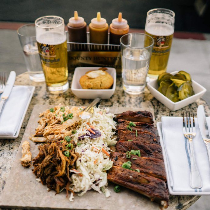 The Taste SF visits Bounty Hunter Wine Bar & Smokin' BBQ in Napa who's bbq platter and beer is the best in napa with a side of corn bread and brick chicken