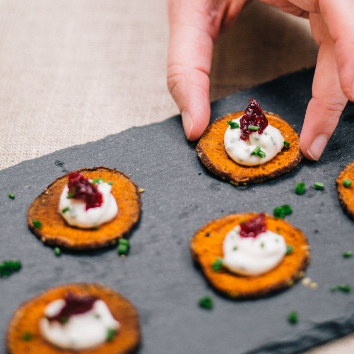 Thanksgiving or Friendsgiving sweet potato bites with Creme Fraiche and cranberries