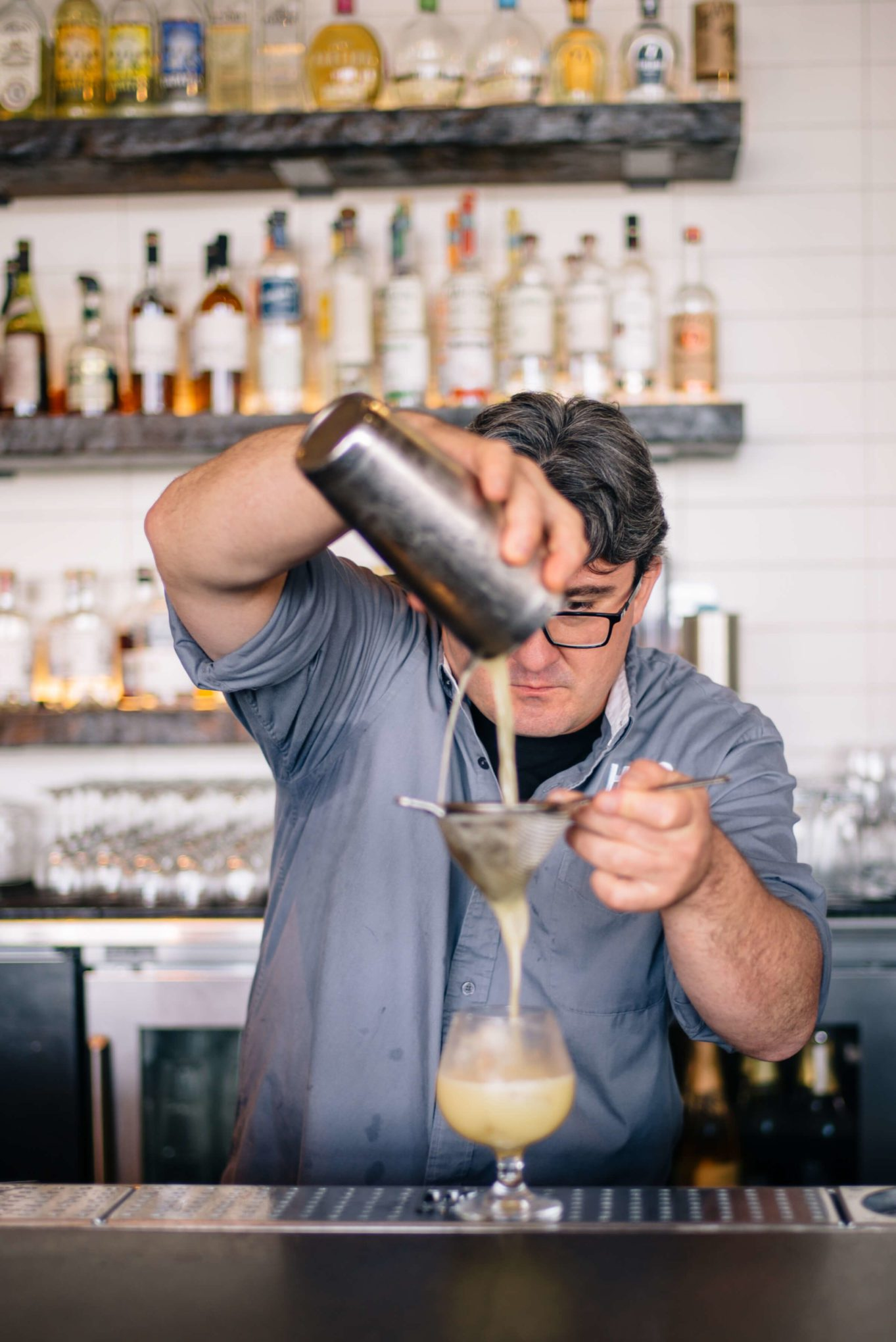 Straining the cocktail for a San Francisco Summer Cocktails: Hog Island Saul Ranella Sacred Cenote Mezcal Amaro Cocktail Recipe, restaurant recipe, The Taste SF