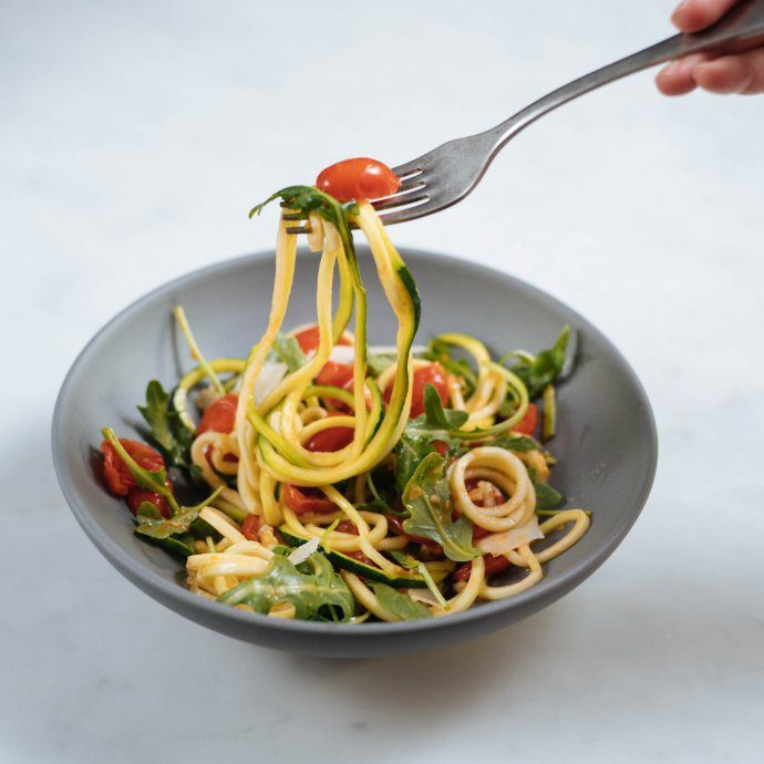 Make zucchini noodles with a fresh tomato sauce for a healthy recipe alternative to pasta by The Taste SF