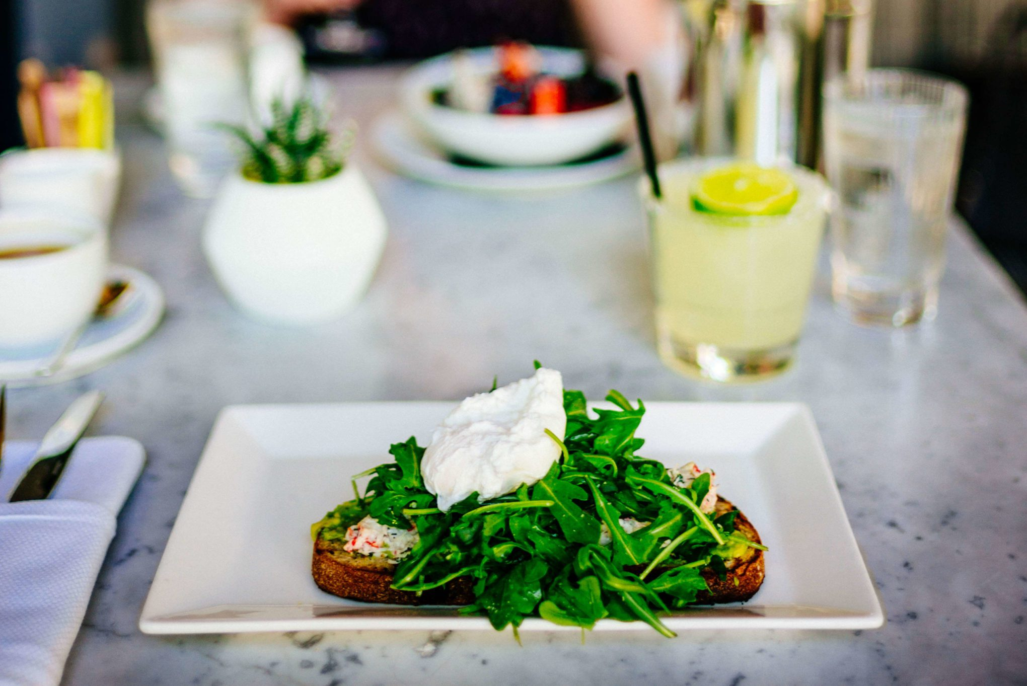 Order the crab and avocado toast at Chi Chi at the Avalon Hotel Palm Springs , The Taste SF