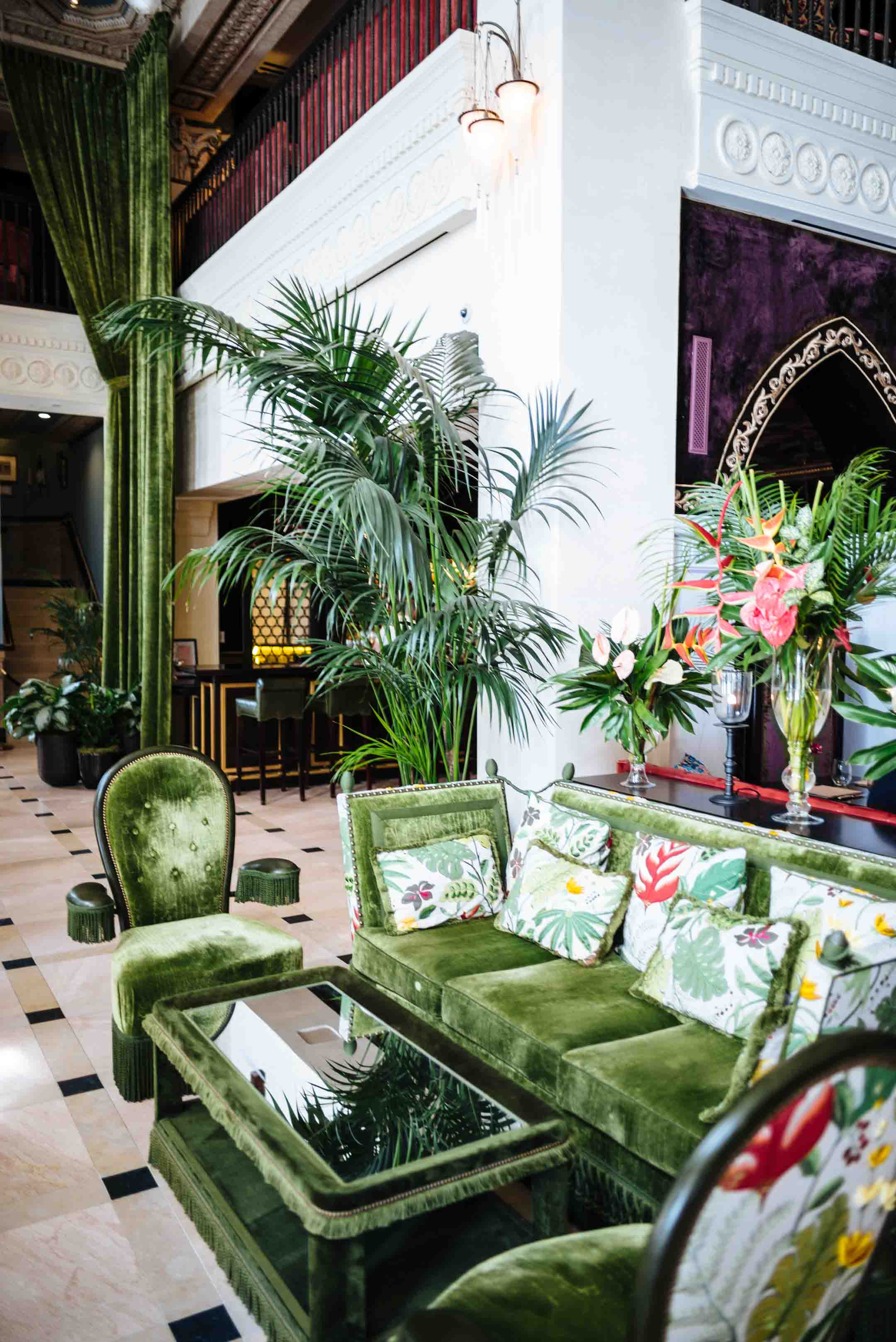 Green Decor in the lobby with green couches and flowers at The Nomad Hotel in downtown LA restaurant