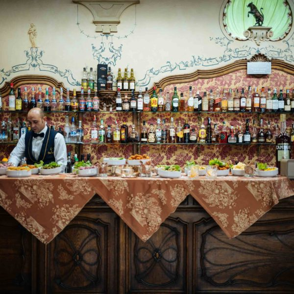 Visit Torino's glamorous historical cafes and bars like Cafe Torino and stop for their apertivo