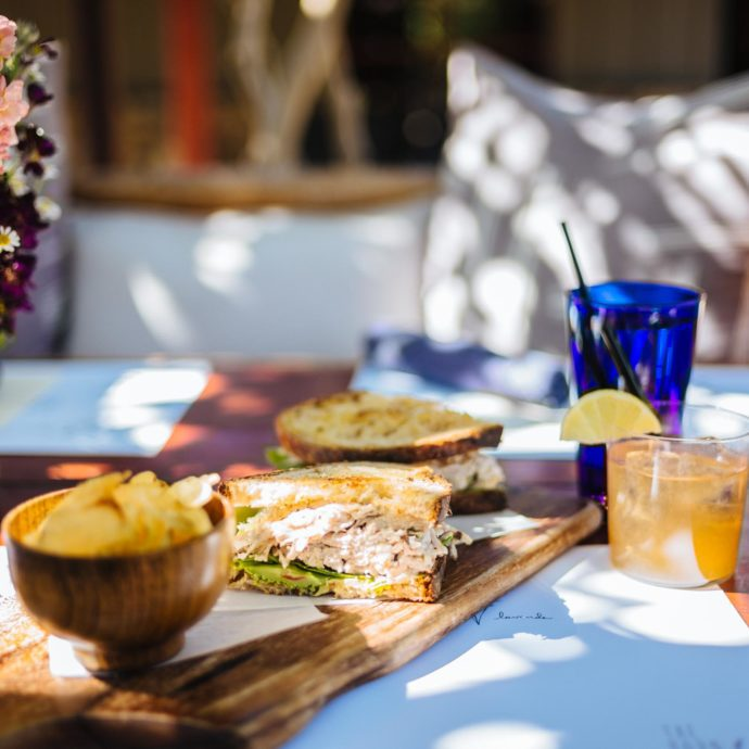Where to eat in Palm Springs, like this local favorite for wine based cocktails and chicken salad for lunches or