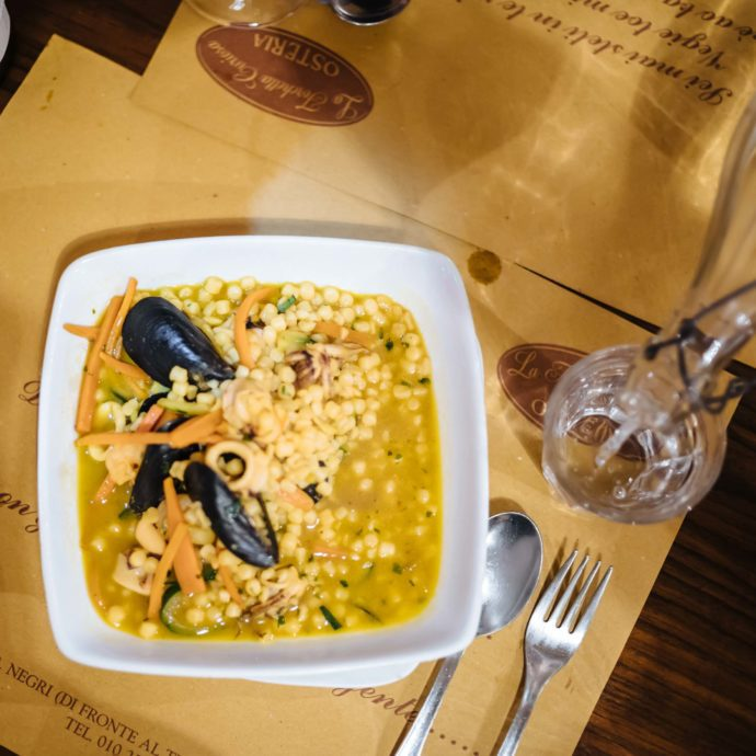 The Taste SF recommends eating at Forchetta Curiosa restaurant in Genova Italy serving local seafood, traditional food, and natural wines