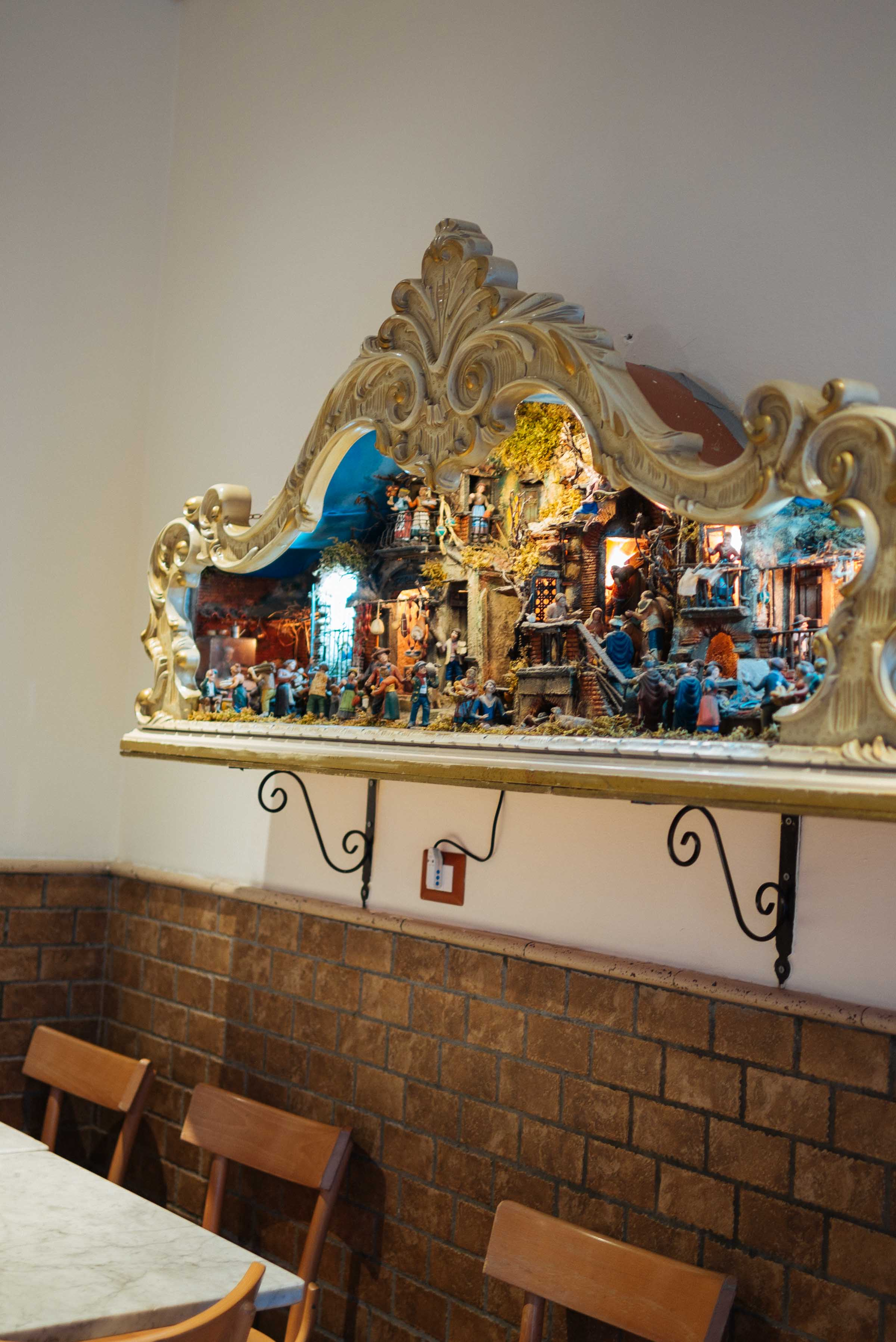 Go to this pizzeria in Napoli for the best pizza in Italy. Simple restaurant decor including this nativity scene. #pizza #nativity #christmas #italy