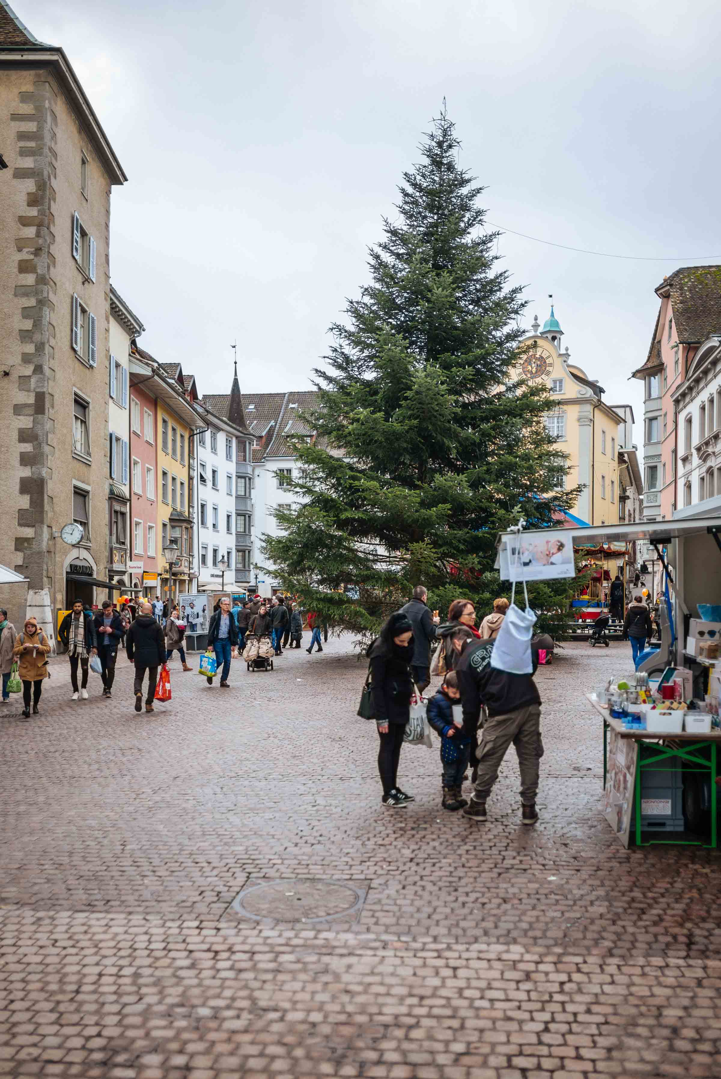 Visit Schaffhausen Switzerland Christmas market in the main square with a giant Christmas Tree