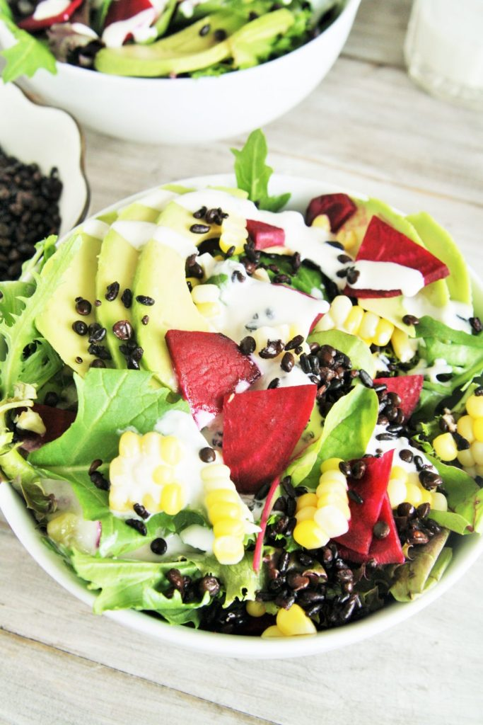This delicious salad is loaded with superfood ingredients such as avocado, corn, beets, and baby spinach tossed in a creamy lemon tahini dressing - light yet hearty enough for lunch or dinner!