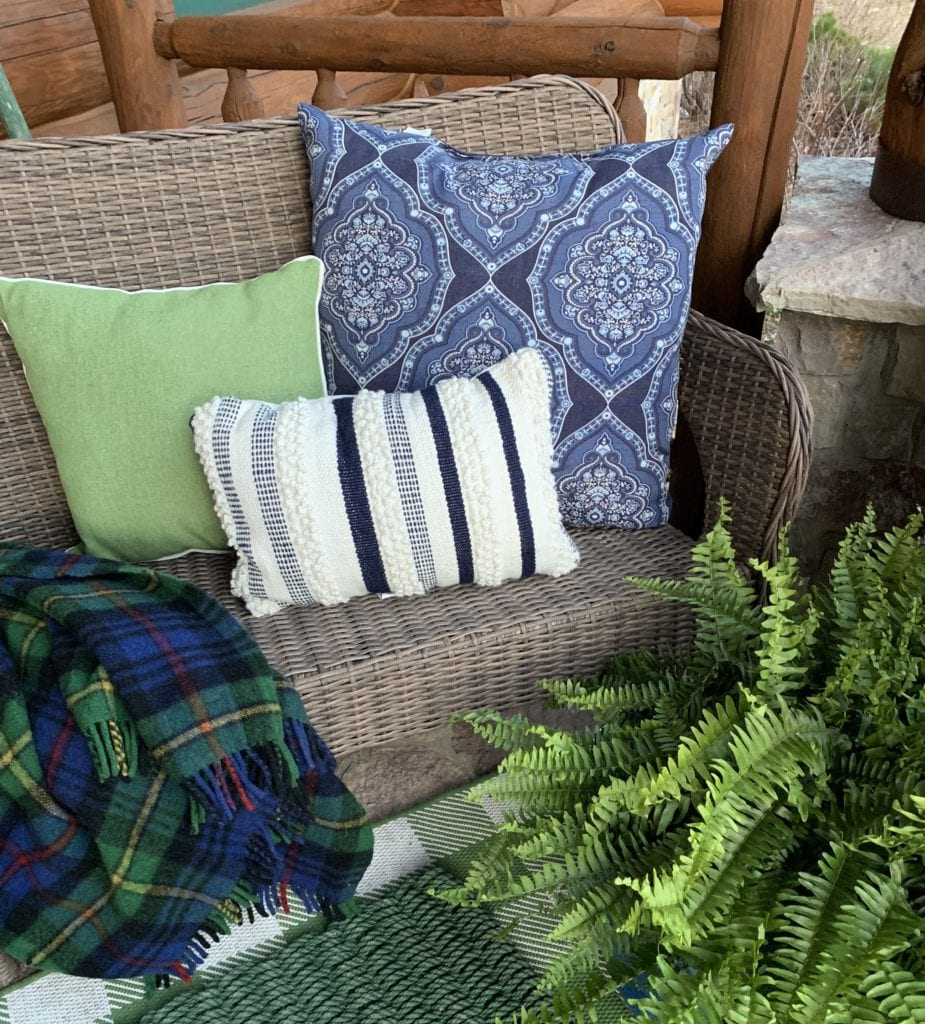 Spring cottage porch with blues and greens.