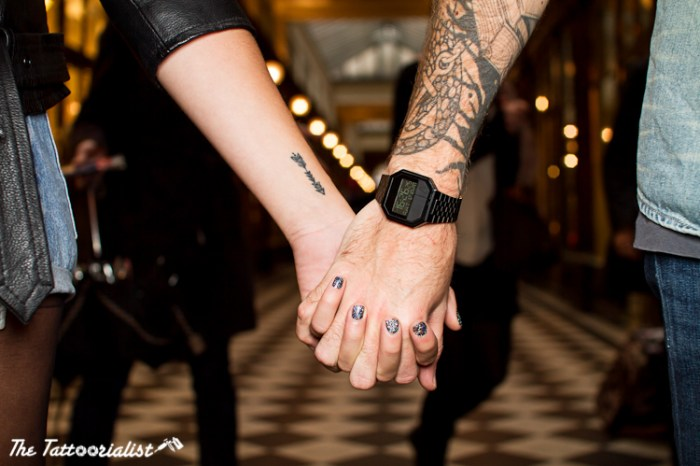 boy and girl with tattoos hand to hand