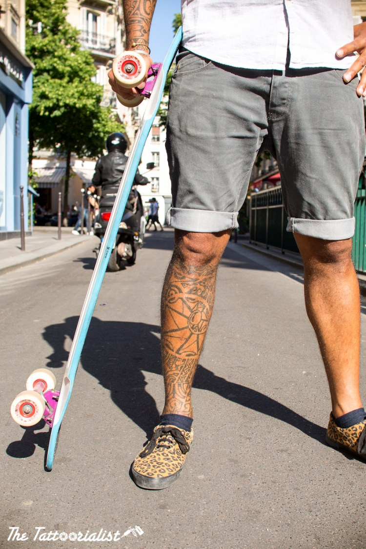 inked man co-founder of RIDEKULTURE with longboard tattooed by Johnny boy and Mauri tatau photo by nicolas brulez aka the tattoorialist