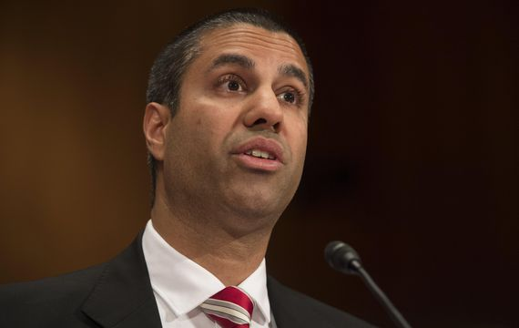 Chairman Ajit Pai of the Federal Communications Commission at microphone, giving testimony to lawmakers in June. A group of Senators asked Pai to investigate phony public comments before holding a vote on the rollback of net neutrality regulations in a letter on Monday.