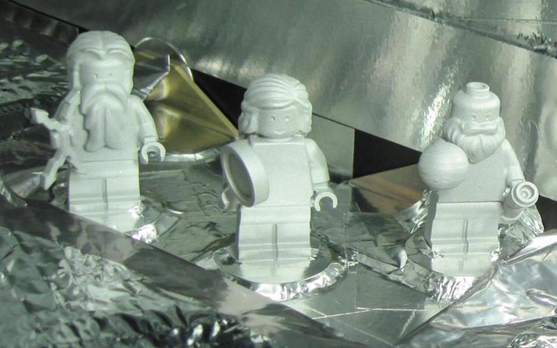 The three LEGO figurines on board, of Jupiter, Juno and Galileo Galilei